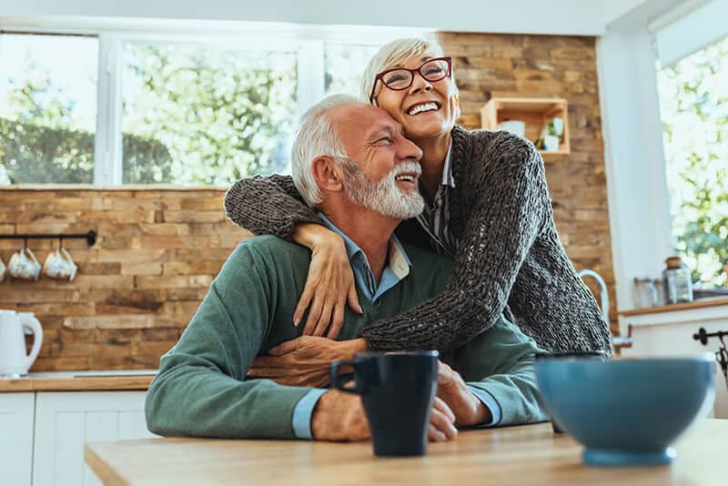 800x534 couple hugging in kitchen istock 1125719715